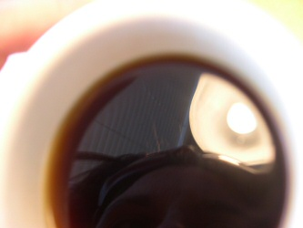 Rox of Spazhouse, peering into her coffee