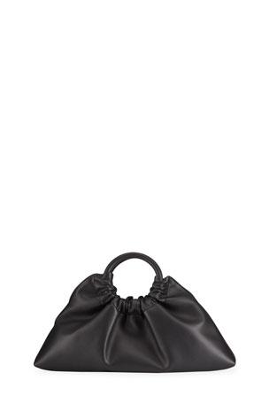 Nanushka Trapeze Ruched Faux-Leather Top-Handle Bag, Black