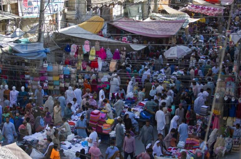 People ignore social distancing shop for the Eid al-Fitr holiday that marks the end of the Muslim holy fasting month of Ramadan after the government relaxed a weeks-long lockdown that was enforced to help curb the spread of the coronavirus, at a market in Rawalpindi, Pakistan. (Image: AP)
