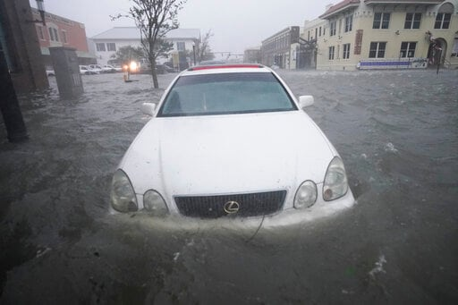 AP Photo Gallery: Sally's Deluge Swamps Streets, Ruins Cars