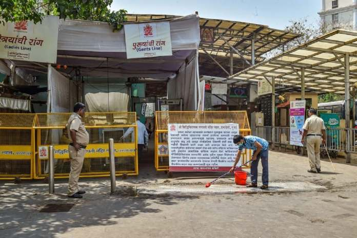 Barricades set up on the entrance of Siddhivinayak Temple after it was closed for public as a measure to prevent the coronavirus pandemic, in Mumbai. (PTI)