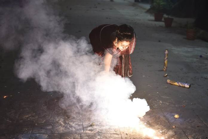 Ghaziabad: People burst fire crackers during 'Diwali' celebrations in Ghaziabad, Saturday, Nov. 14, 2020. Due to rising air pollution and risk of spike in Covid infections, various states and Union Territories across the country have either imposed a complete ban on fire crackers on Diwali or permitted them with heavy restrictions. (PTI Photo/Arun Sharma)