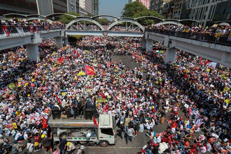 Demonstrators gather in an intersection close to Sule Pagoda to protest against the military coup in Yangon, Myanmar, Wednesday, Feb. 17, 2021. (Image: AP)