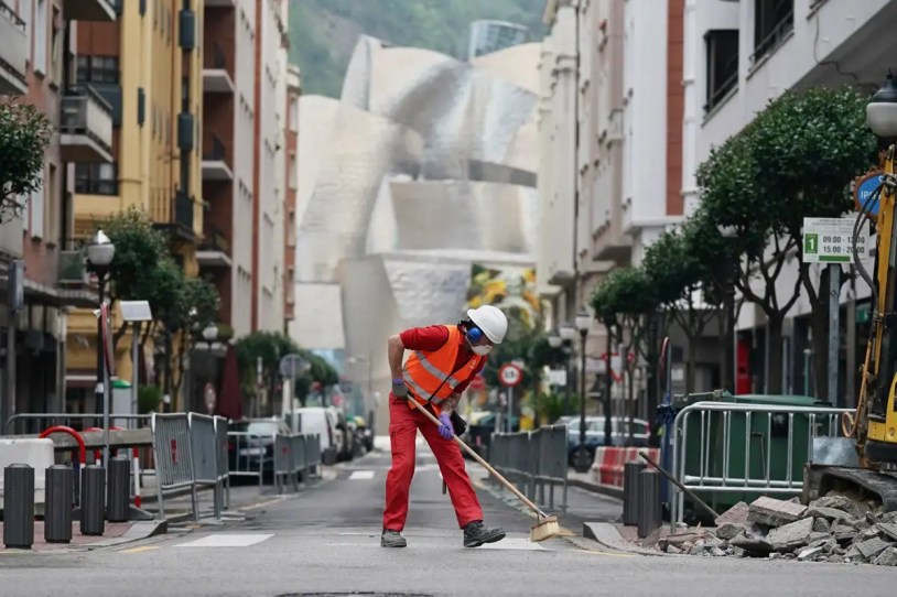 care of elderly - a worker on the streets of bilbao