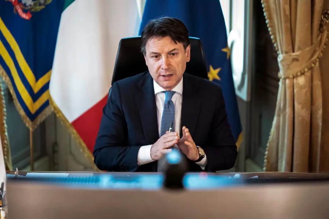 Italian prime minister at his desk on video call