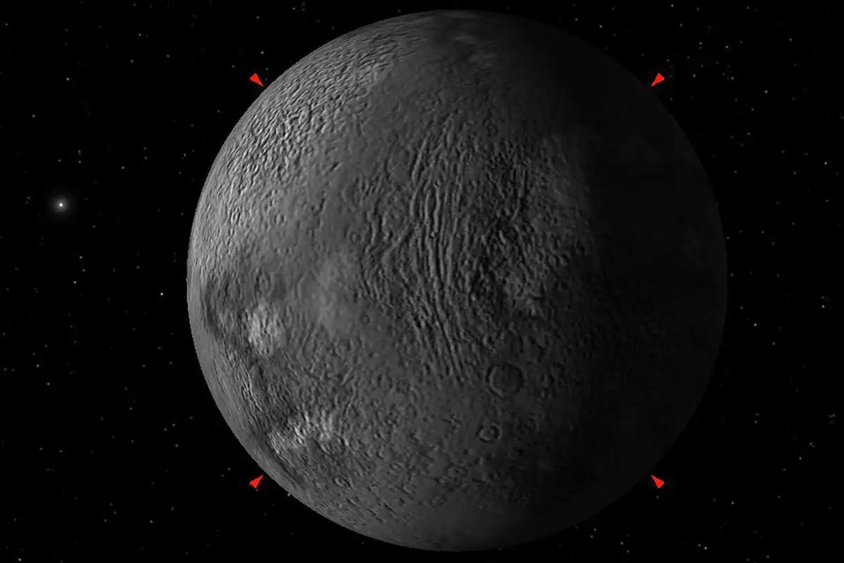 A large moon might be hugging an object in the outer solar system