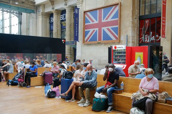People sitting and waiting in a train station