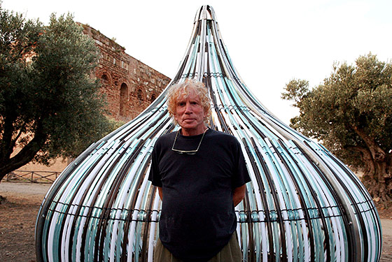 Dennis Oppenheim in 2009, in front of a piece he created for