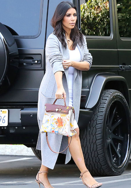 Kim Kardashian proudly sported the bag painted by North West on Monday [Splash]