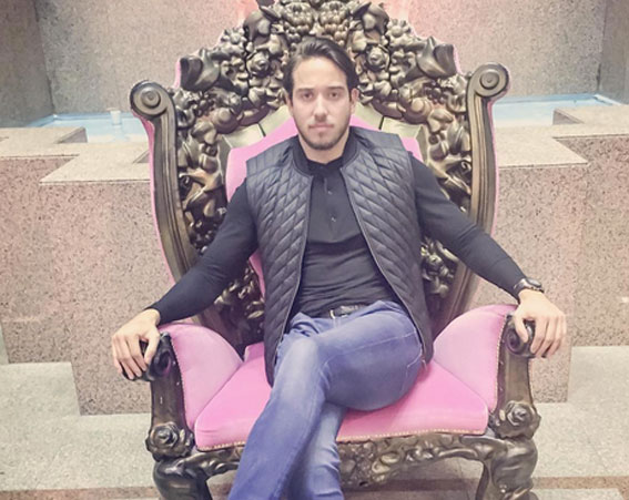 James Lock posing in a Big Brother chair [James Lock/Instagram]
