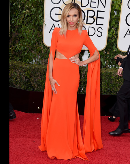 Giuliana Rancic stands out in a bright orange dress – gorgeous [Getty]