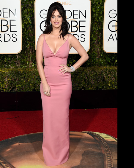 Katy Perry keeps it simple in a very low cut rose pink dress [Getty]