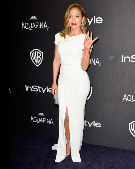 Jennifer Lopez changes into a white dress for the after party [Getty]