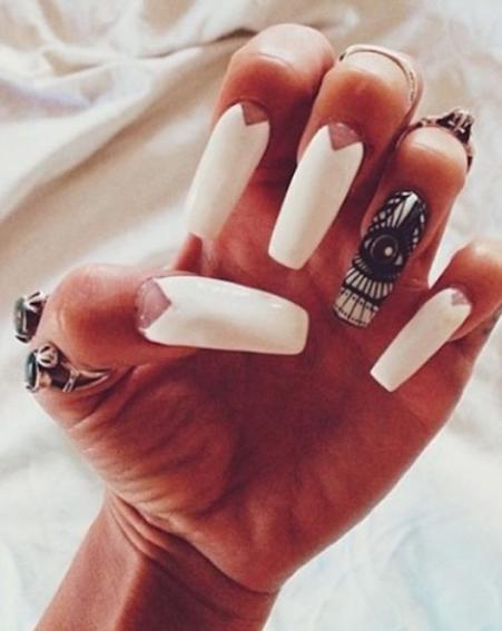Former High School Musical star Vanessa Hudgens goes for the white triangle nail art trend [Vanessa Hudgens/Instagram]