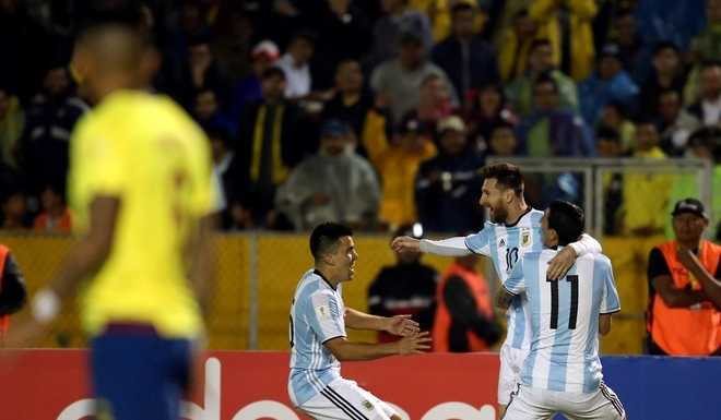 Soccer Football - 2018 World Cup Qualifiers - Ecuador v Argentina - Olimpico Atahualpa stadium, Quito, Ecuador - October 10, 2017. Argentinas Lionel Messi celebrates with teammates Angel Di Maria (R) and Marcos Acuna after he scored his teams second goal. REUTERS/Edgard Garrido