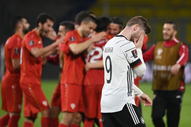 North Macedonia players celebrate as Germany's forward Timo Werner walks past after the FIFA World Cup Qatar 2022 qualification football match Germany v North Macedonia in Duisburg, western Germany on March 31, 2021. (Photo by Ina Fassbender / AFP)