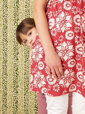 Image result for child hiding behind