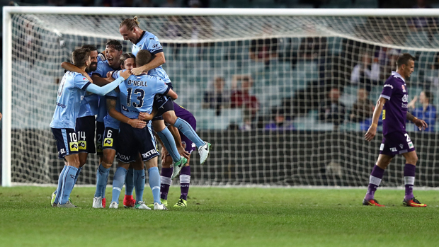 Sydney FC players celebrate after Josh Brillante's opening goal in their big semi final win over Perth Glory.