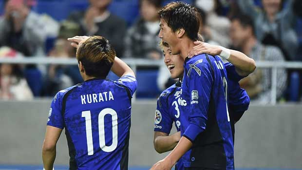 Gamba Osaka players celebrate a goal  in their win over Adelaide United in the ACL on Tuesday night.