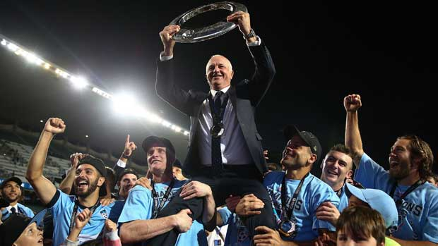 Sydney FC coach Graham Arnold has challenged his Hyundai A-League double-winning side to defend their championship next season.