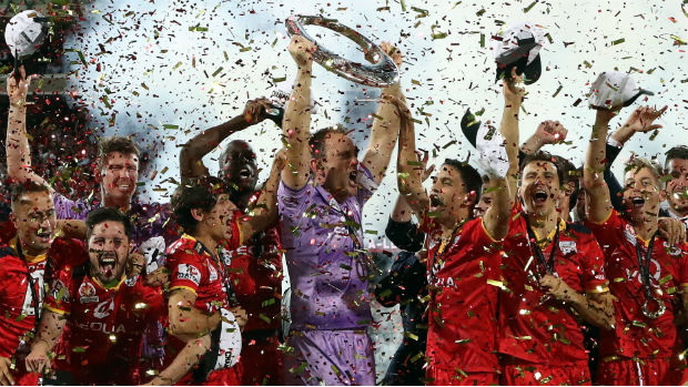 Adelaide United celebrate winning the 2015/16 Hyundai A-League championship.