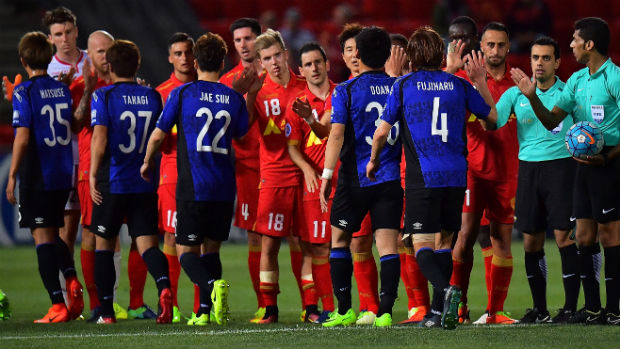 Adelaide United and Gamba Osaka players ahead of kick-off in their ACL opener on Wednesday night.