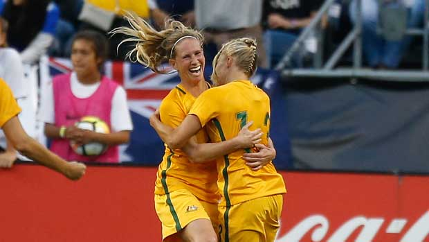 Elise Kellond-Knight celebrates with Tameka Butt after a Westfield Matildas goal at the recent Tournament of Nations.