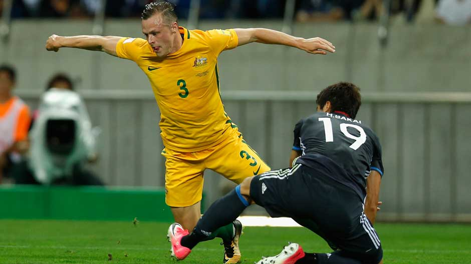 Brad Smith goes down under a mis-timed tackle from a Japanese defender.