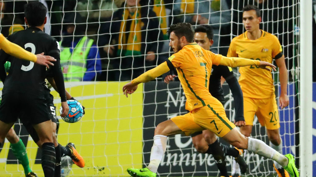 Mat Leckie netted late on to hand Australia a 2-1 win over Thailand in Melbourne.