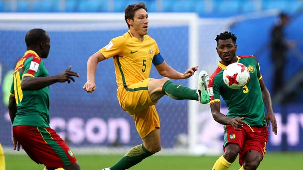 Skipper Mark Milligan beats two defenders to the ball to win possession for the Caltex Socceroos.