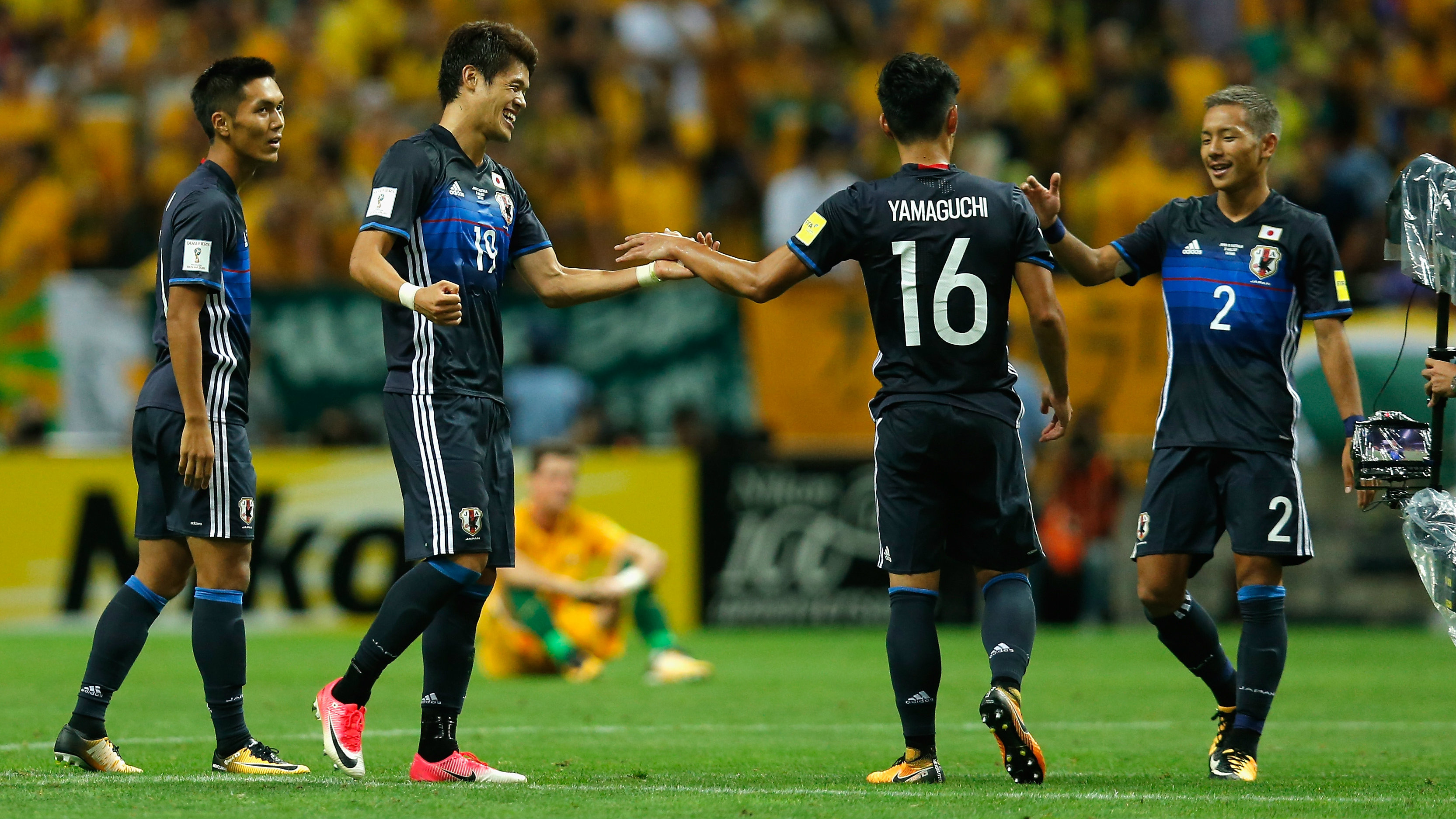Japanese players celebrate a goal in their 2-0 win over the Caltex Socceroos.