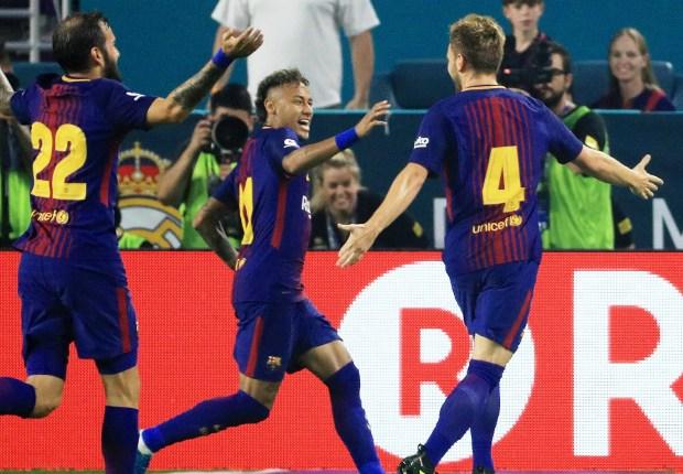 Barcelona celebrate a goal against Real Madrid