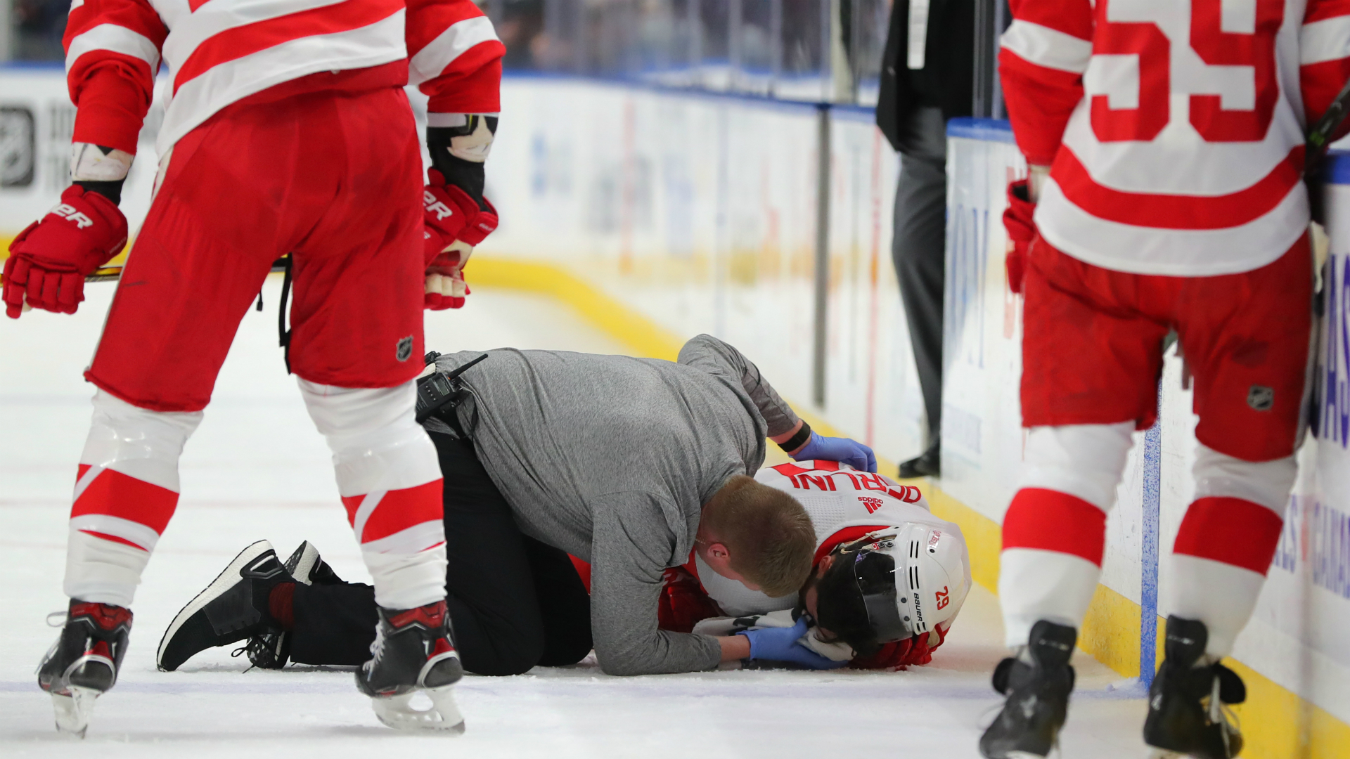 Detroit Red Wings' Brendan Perlini cut in face by skate, receives stitches after scary play