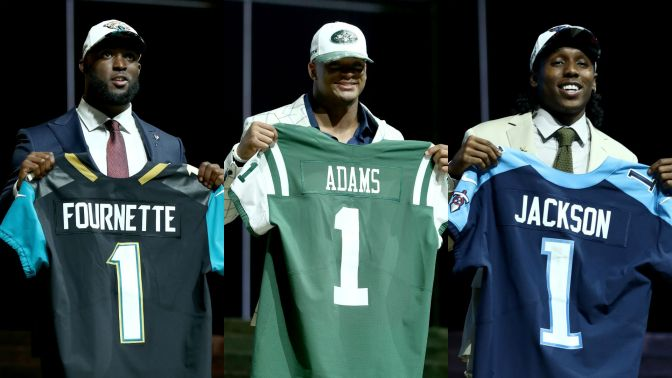 NFL Rookies Leonard Fournette, Jamal Adams, and Adoree Jackson holding their jerseys after being drafted