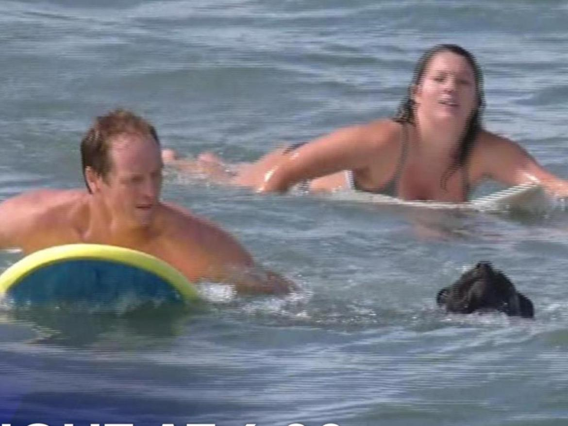 The surfers rescued the woman, who was swept out about 100m.
