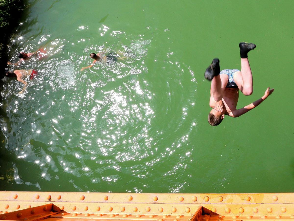 People cooling off in lakes and rivers across Europe has led to a spike in drownings and rescues.