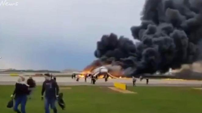 Image result for 41 Dead As Plane Bursts Into Flames While Making Emergency Landing Inside Airport (Photos)