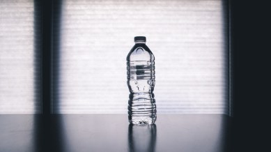 Clear Disposable Bottle on Black Surface