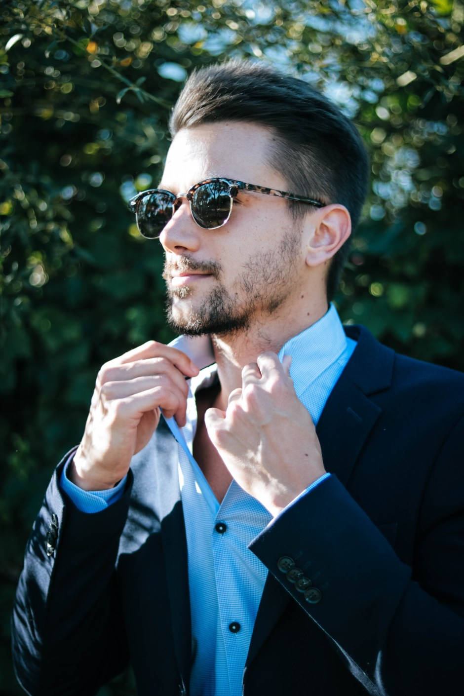 Man in Blue Dress Shirt and Black Formal Suit