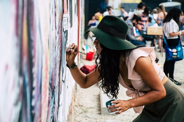 Love Photo of Self-expression Woman Painting on Wall