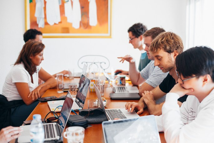 Group Of People Using Laptops
