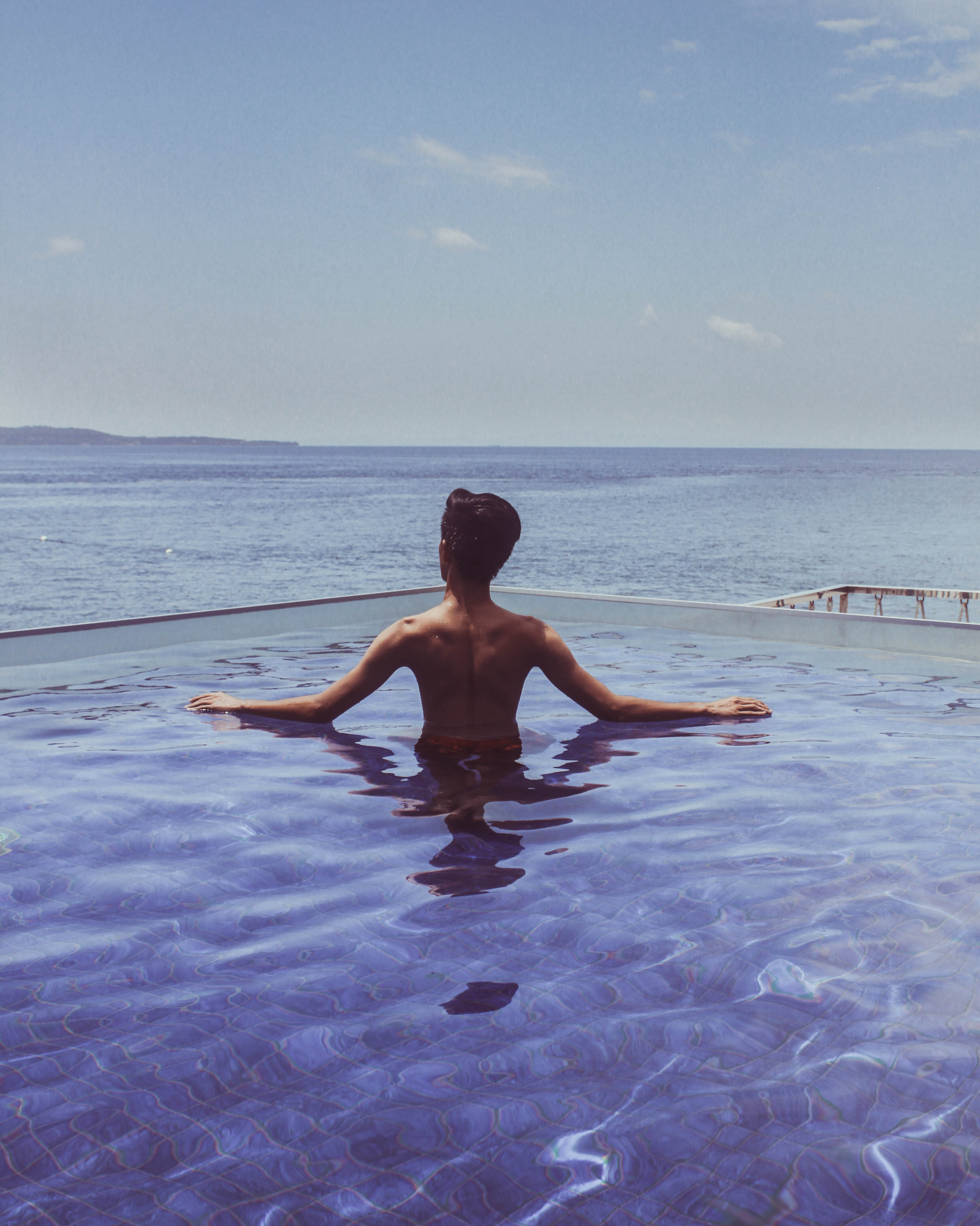 Person Swimming In Body Of Water Free Stock Photo