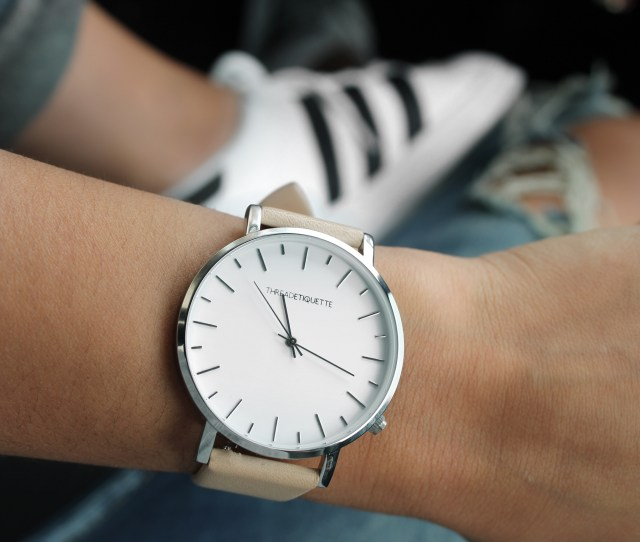 Beige Strap Silver Roundog Watch Behind Adidas White And Black Superstar