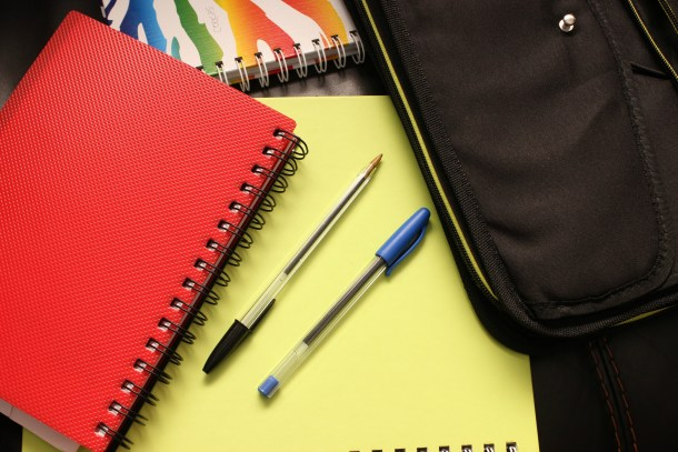 spiral notebooks and pens