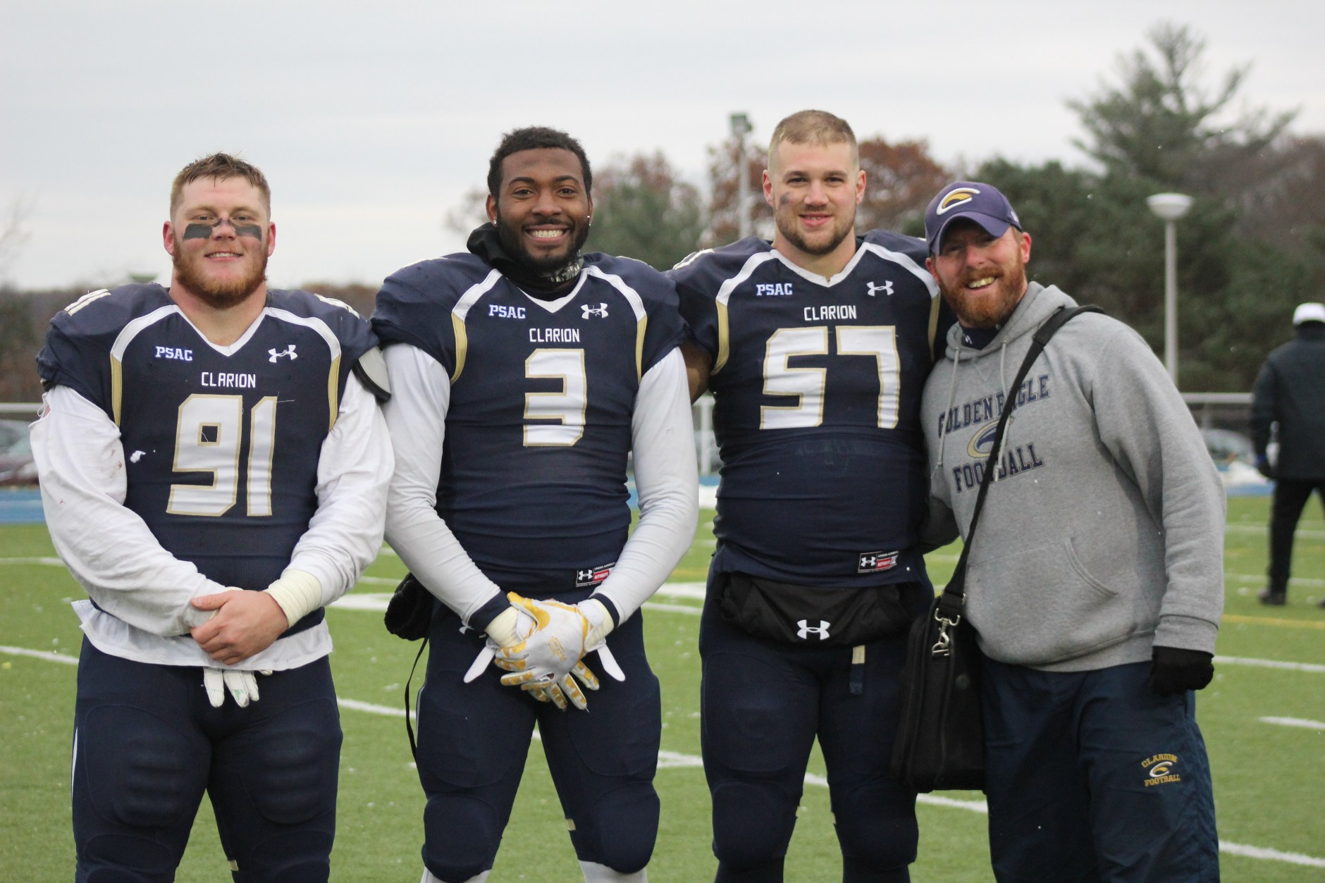 Photo of a football coach and football players