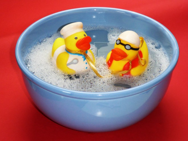 2 Rubber Ducky on Blue Ceramic Bowl