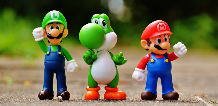 Focus Photo of Super Mario, Luigi, and Yoshi Figurines