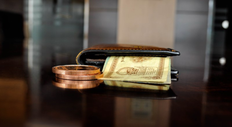 Brown Leather Bifold Wallet With Banknotes Sticking Out