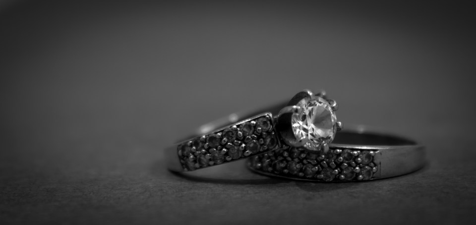 Grayscale Photo of 2 Silver With Diamond Rings