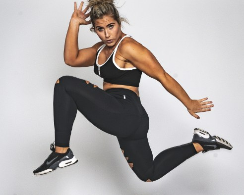 Photo of Leaping Woman in Black Active-wear